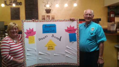 Broadway Lions Club President Teresa Kelly with DG  Vince Schimmoller showing the Dream Board that their club has developed.